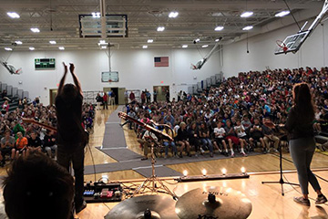 Rock Bands Tour Nebraska and Teach Students Lessons in Personal Finance
